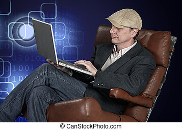 Man sitting indoors using laptop