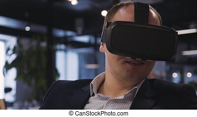 Man sitting inside office in 3d glasses and spending free...
