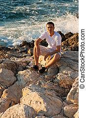 Man Sitting Near The Sea