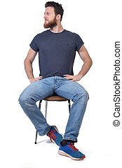 man sitting on a chair look side on white