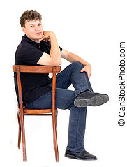 man sitting on a chair on a white background