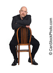 man sitting on a chair on white background