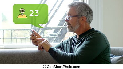 Man sitting on a couch while typing on his phone 4k