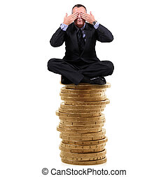 man sitting on a stack of coins