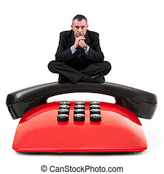 man sitting on an old phone