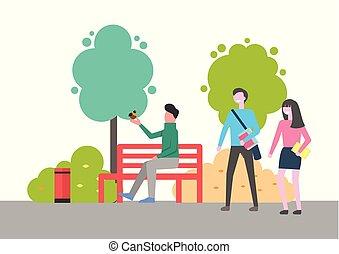 Man Sitting on Bench Holding Bird on Hand in Park