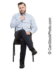 man sitting on chair. Isolated white background. touch button