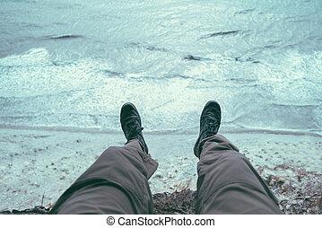 Man sitting on coast