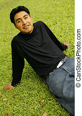 Man Sitting On Grass