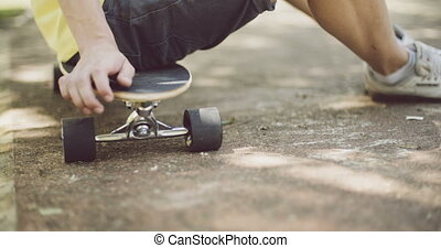 Man sitting on his skateboard