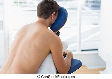 Man sitting on massage chair