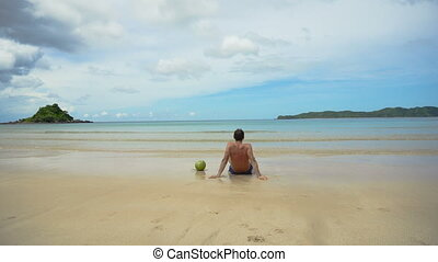 Man sitting on the beach.