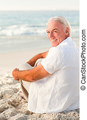 Man sitting on the beach