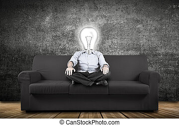 man sitting on the couch with an idea on the head