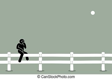 Man sitting on the fence.