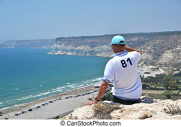 Man sitting on the rock, Cyprus