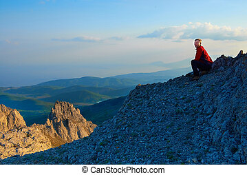 Man sitting on the rock