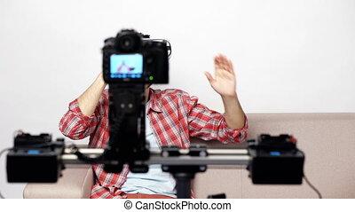 Man sitting on the sofa smiling at camera