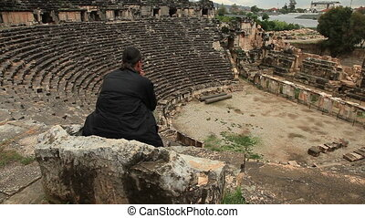 Man sitting on the stone chair