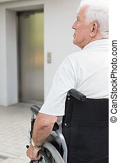 Man sitting on the wheelchair - Independent senior man...
