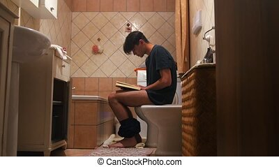 Man Sitting On Toilet and reading a book - somebody opens...