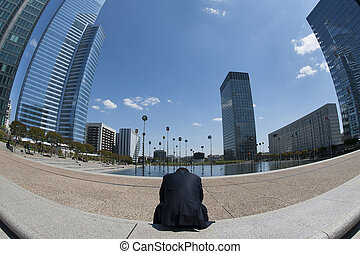 Man sitting tired and lonely in business district