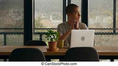 Man sitting with laptop at home 4k
