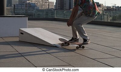 Man skater making ollie with jump outdoors - Skillful...