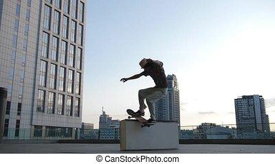 Man skater sliding on ledge during extreme ride - Skillful...