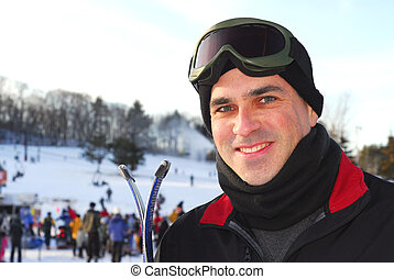 Portrait of a happy attractive man on downhill ski resort