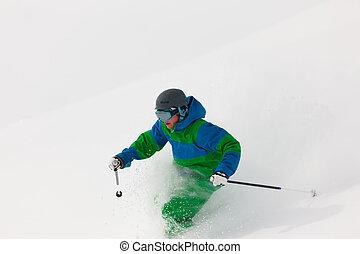Man skiing downhill - Man on a ski track going downhill,...
