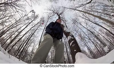 Man skiing in a winter forest. Action camera is mounted on...