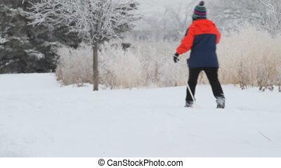 Man skiing in winter city park