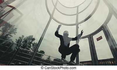 Man skydiver flies in wind tunnel. Indoor skydiving wind...