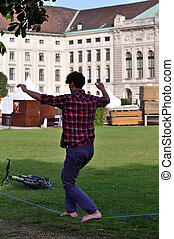 man slacklining in front of vienna's hofburg