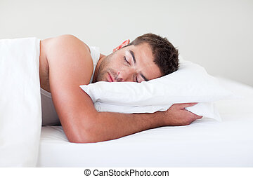 Man sleeping in bed - Young man sleeping in bed