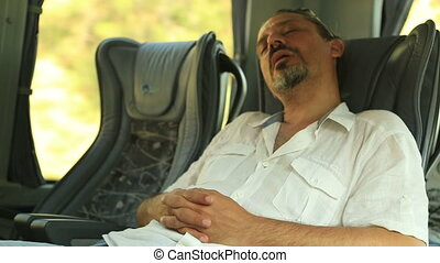 Man Sleeping In Bus