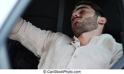 Man sleeping in his car then waking up