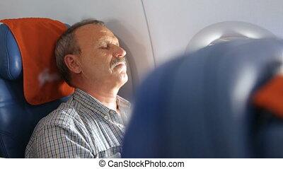 Man sleeping in the airplane