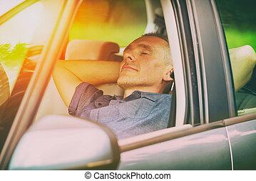 Man sleeping in the car