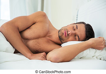 Man sleeping on the bed at home