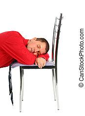 man sleeping on the chair