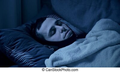 Man sleeps with bandage on a head from snoring