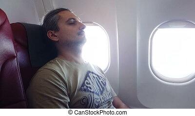 man sleeps In Plane