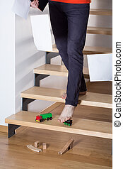 Man slip on a toy left on stairs