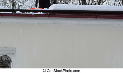 man slope roof snow fall