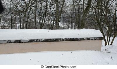man slope roof snow
