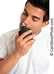 Man smelling aftershave cologne - A man samples the smell of...