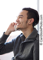 Man smiling and talking on cellphone