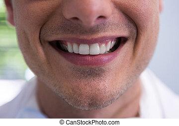 Man smiling at dentist office